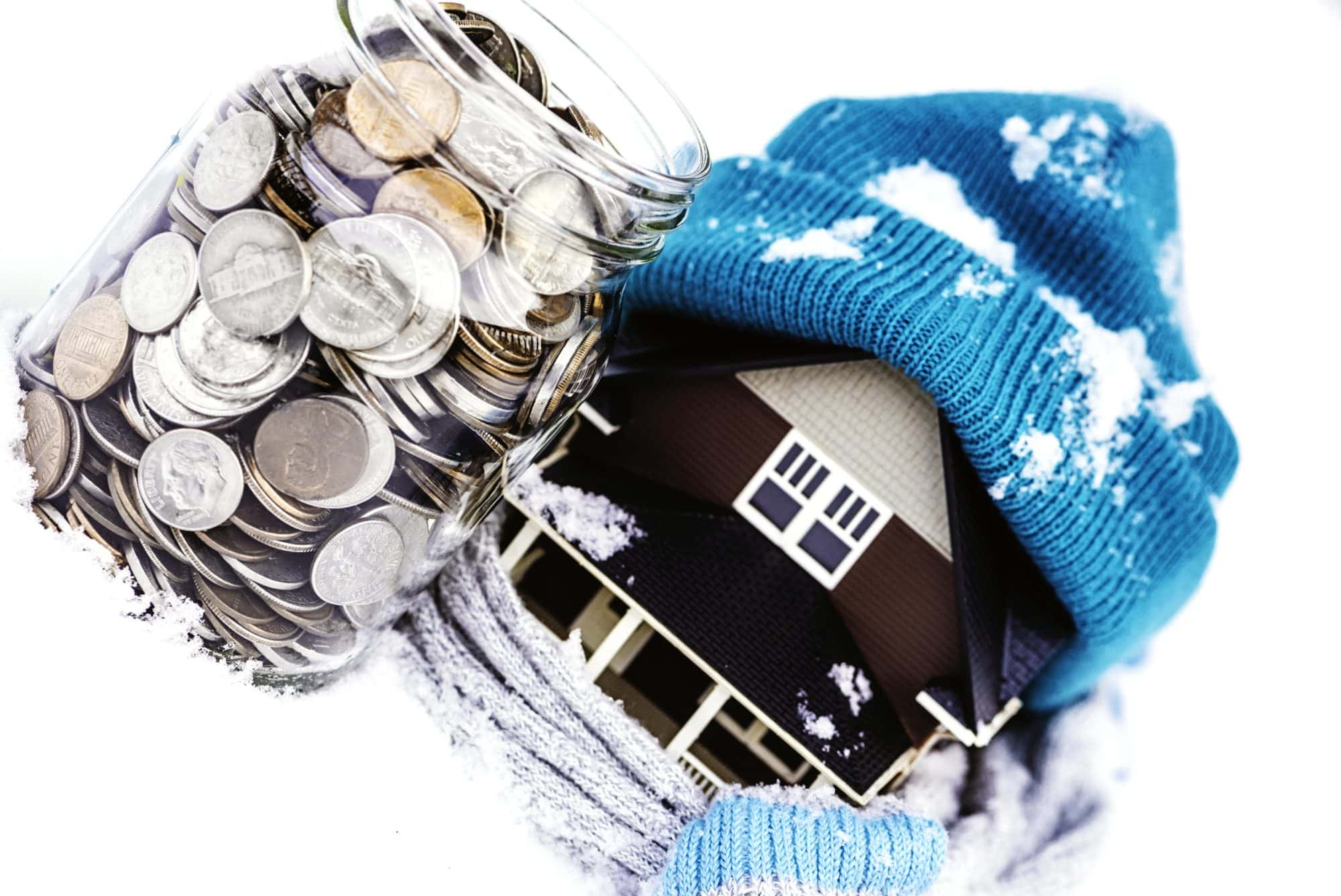 House-bundled-in-scarf-and-hat-next-to-jar-of-change-.jpg