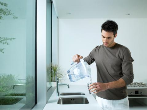 Man-pouring-glass-of water-.jpg