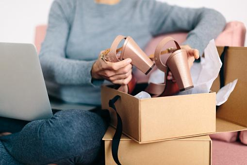 Woman-taking-new-high-heels-out-of-box-.jpg