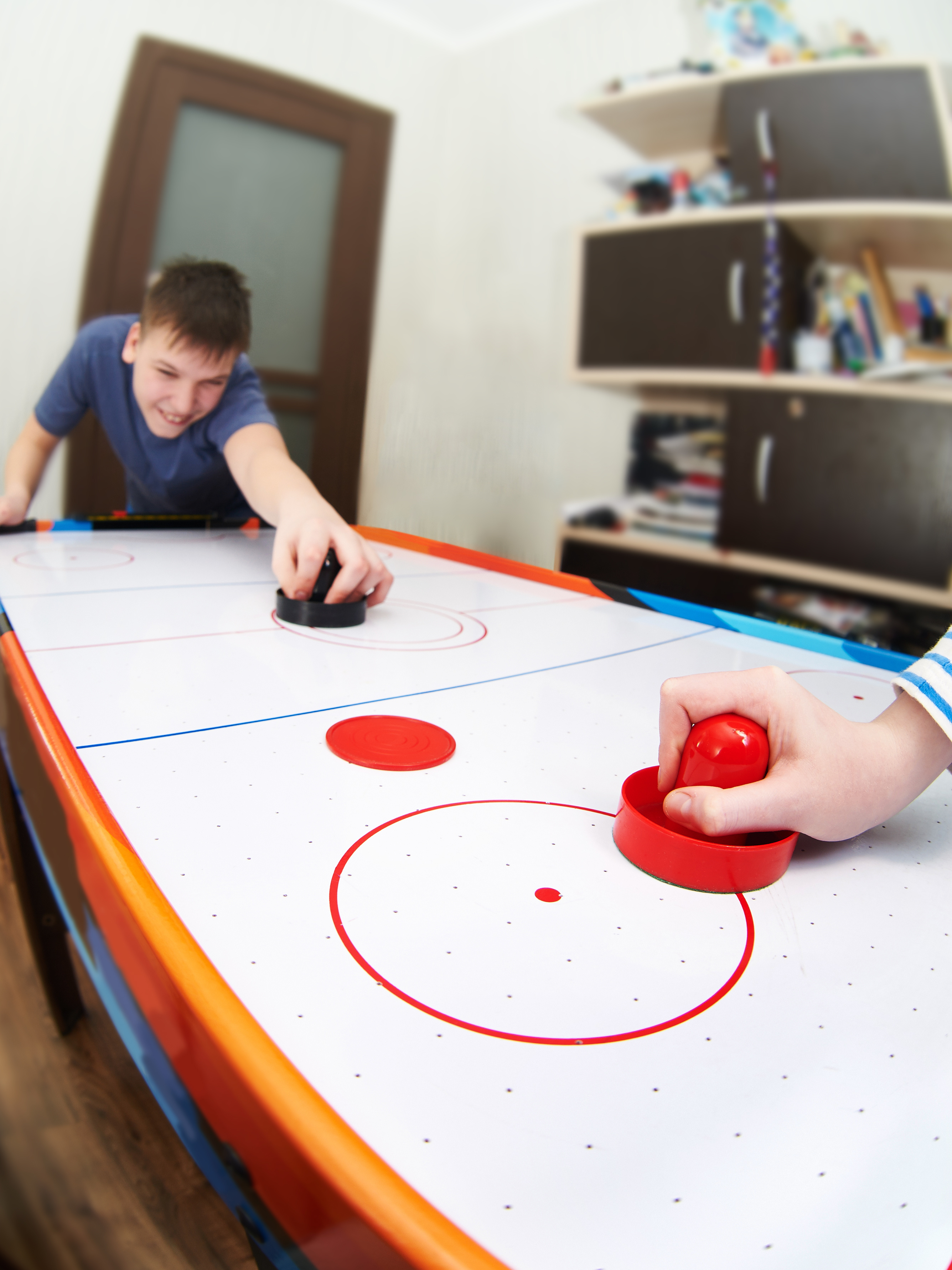 /boys-playing-air-hockey.jpeg