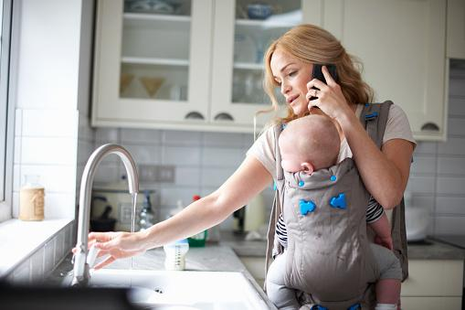 mother-holding-baby-on-the-phone.jpg