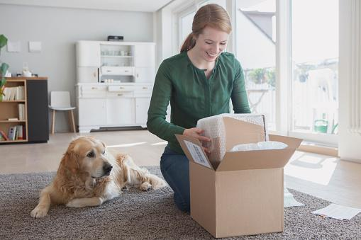 woman-packing-with-dog.jpg